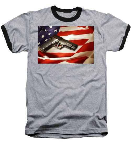 Gun On Flag Baseball T-Shirt by Les Cunliffe