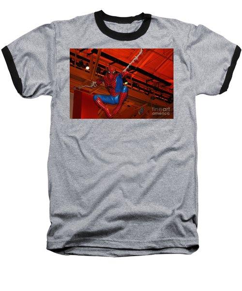 Spiderman Swinging Through The Air Baseball T-Shirt by John Telfer