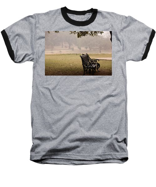 Baseball T-Shirt featuring the photograph A Wrought Iron Black Metal Bench Under A Tree In The Qutub Minar Compound by Ashish Agarwal