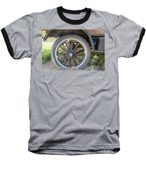Baseball T-Shirt featuring the photograph Old Truck Tire In Rural Rocky Mountain Town by Peter Ciro