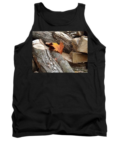 Tank Top featuring the photograph Maple Leaf In Wood Pile by Brenda Brown