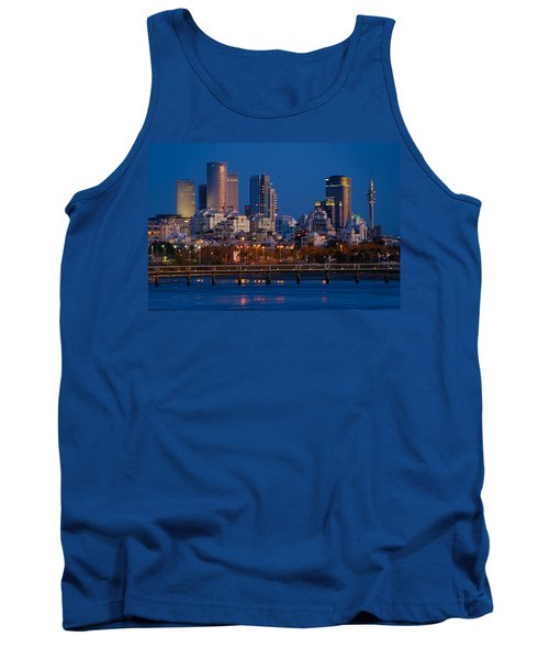 Tank Top featuring the photograph city lights and blue hour at Tel Aviv by Ron Shoshani