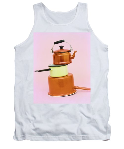 A Brass Teapot Stocked On Top Of Pots Tank Top