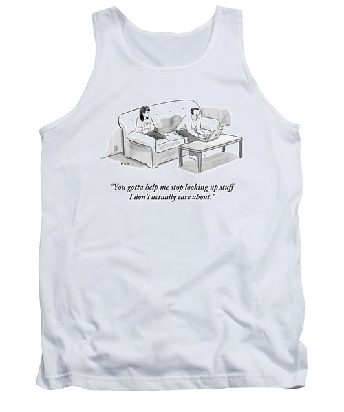 A Man And A Woman Sit On A Couch.  The Man Tank Top