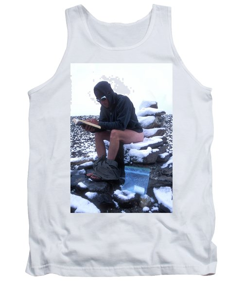 A Man Reads While Using A Snow-covered Tank Top