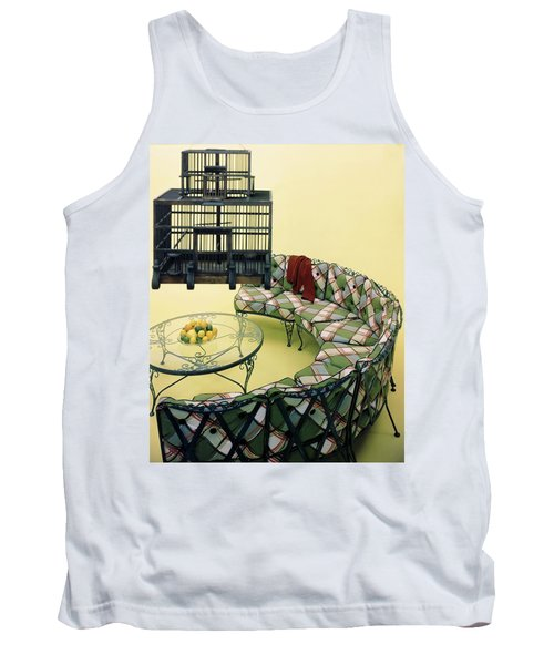 A Round Couch And A Birdcage Tank Top