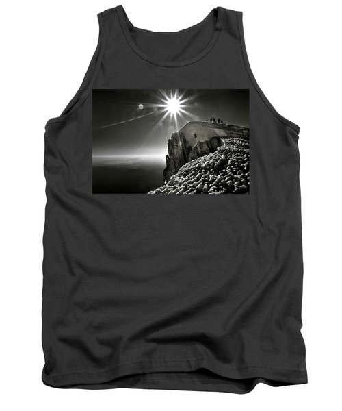 A Group Of Mountaineers Reach Tank Top
