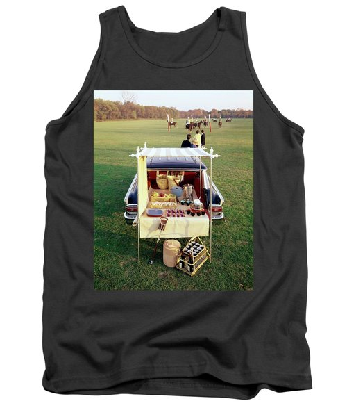 A Picnic Table Set Up On The Back Of A Car Tank Top