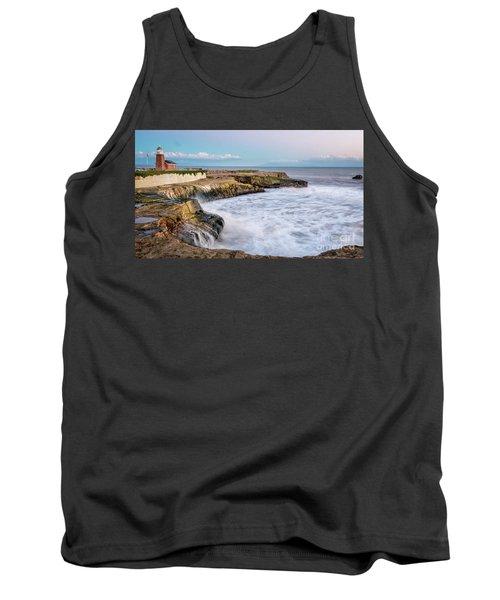 Long Exposure Of Waves Against The Cliff With Lighthouse In Shot Tank Top