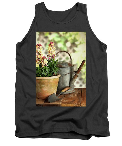 Old Watering Can With Plant Tank Top