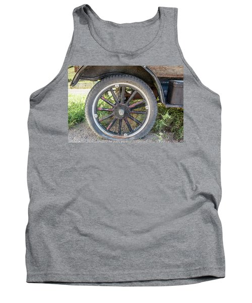 Tank Top featuring the photograph Old Truck Tire In Rural Rocky Mountain Town by Peter Ciro