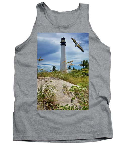 Tank Top featuring the photograph Pelican Flying Over Cape Florida Lighthouse by Justin Kelefas
