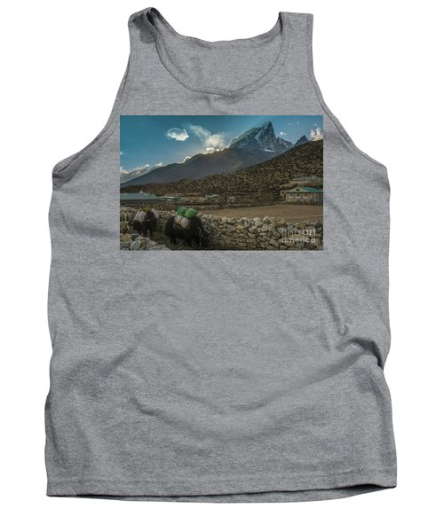 Tank Top featuring the photograph Yaks Moving Through Dingboche by Mike Reid