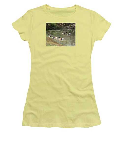 Women's T-Shirt (Junior Cut) featuring the photograph Canadian Geese Feeding In Backwaters by William Tanneberger