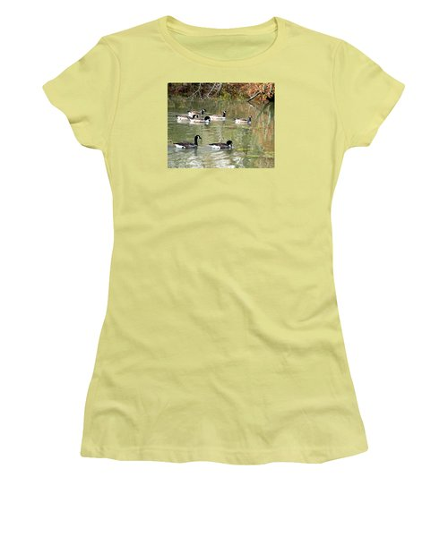 Women's T-Shirt (Junior Cut) featuring the photograph Canadian Geese Swimming In Backwaters by William Tanneberger
