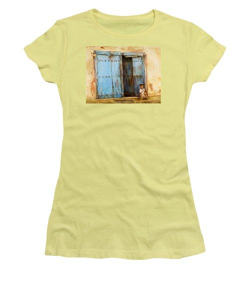 Women's T-Shirt (Junior Cut) featuring the painting Child Sitting In Old Zanzibar Doorway by Sher Nasser