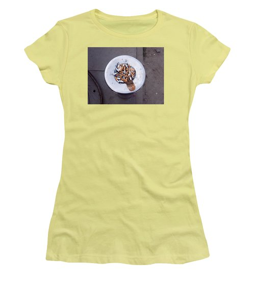 Women's T-Shirt (Junior Cut) featuring the photograph A Lot Of Cigarettes Stubbed Out At A Garbage Bin by Ashish Agarwal