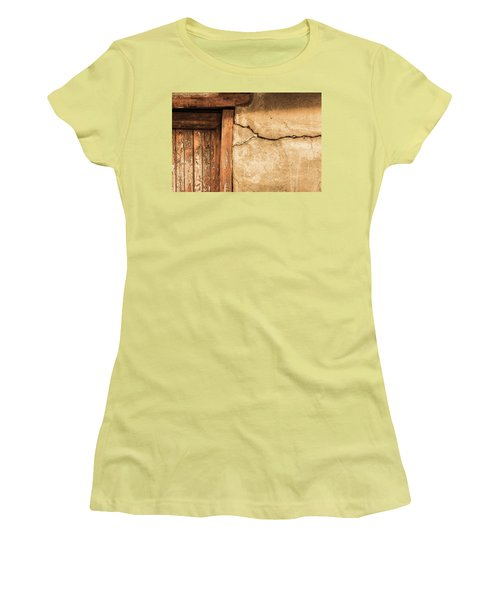 Cracked Lime Stone Wall And Detail Of An Old Wooden Door Women's T-Shirt (Junior Cut) by Semmick Photo