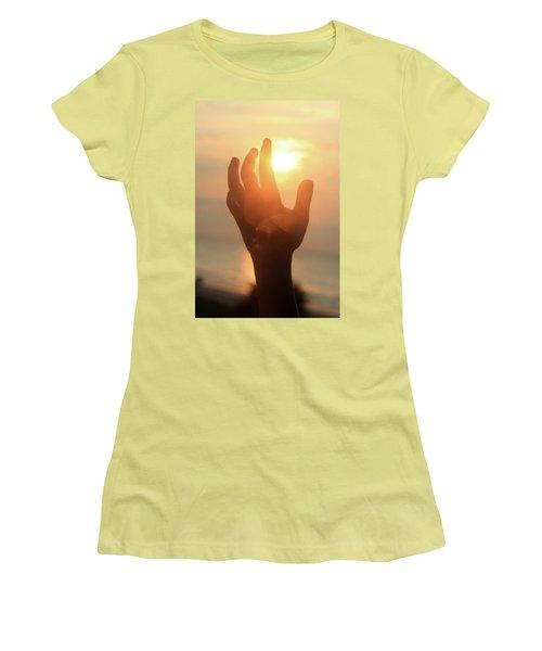 Hand Reaching Fore The Sun Women's T-Shirt (Junior Cut) by Emanuel Tanjala