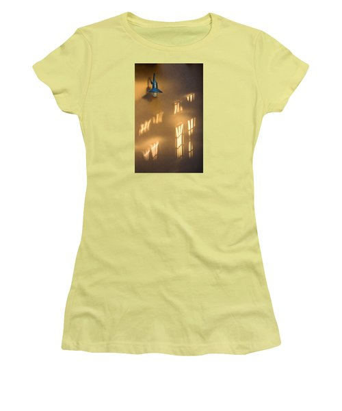 Women's T-Shirt (Junior Cut) featuring the photograph Lonely Lamp Among Sunrise Window Light Reflections by Gary Slawsky