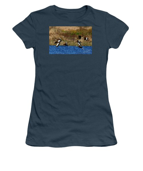 Women's T-Shirt (Junior Cut) featuring the photograph Flight Of The Whistlers by Myrna Bradshaw