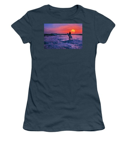 Surfer On Rock Looking Out From Blowing Rocks Preserve On Jupiter Island Women's T-Shirt (Junior Cut) by Justin Kelefas