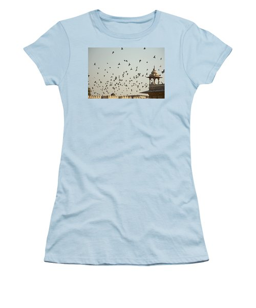 Women's T-Shirt (Junior Cut) featuring the photograph A Flock Of Pigeons Crowding One Of The Structures On Top Of The Red Fort by Ashish Agarwal
