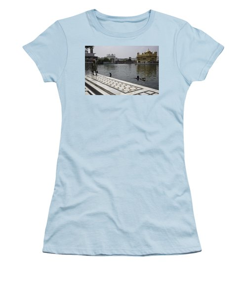 Women's T-Shirt (Junior Cut) featuring the photograph Clearing The Sarovar Inside The Golden Temple Resorvoir by Ashish Agarwal
