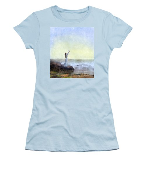 Young Lady Releasing A Dove By The Sea Women's T-Shirt (Athletic Fit)