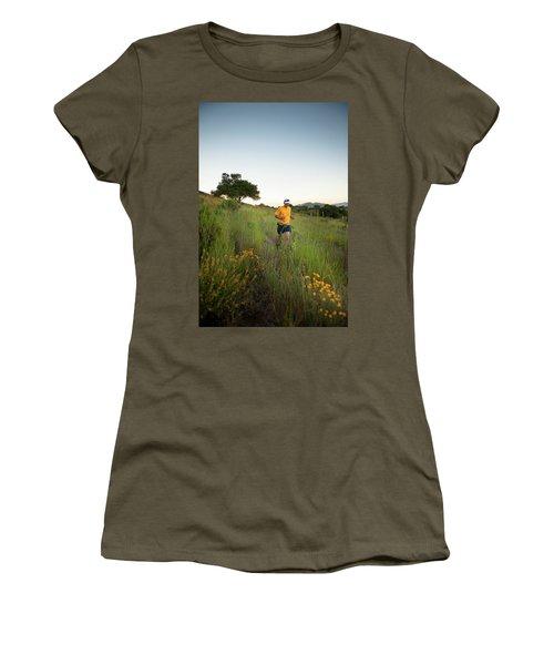 A Trail Runner Passes Wildflowers Women's T-Shirt