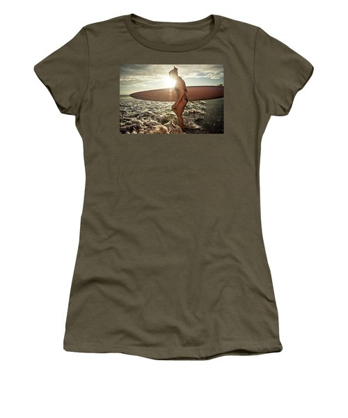 A Young Woman Carries Her Paddleboard Women's T-Shirt
