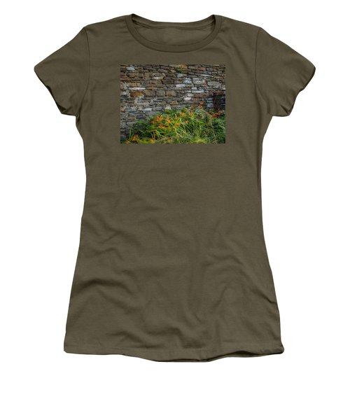 Orange Wildflowers Against Stone Wall Women's T-Shirt