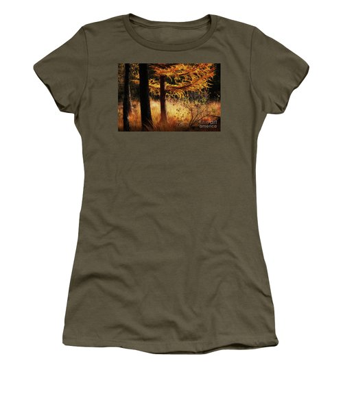 Women's T-Shirt featuring the photograph Autumn Scene In A Dark Forest by Nick Biemans