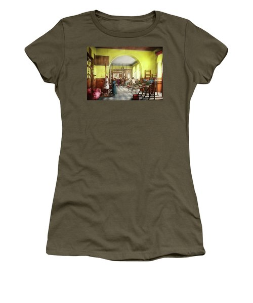 Women's T-Shirt (Athletic Fit) featuring the photograph Doctor - Physical Therapist - Welcome To The A Traction 1918 by Mike Savad