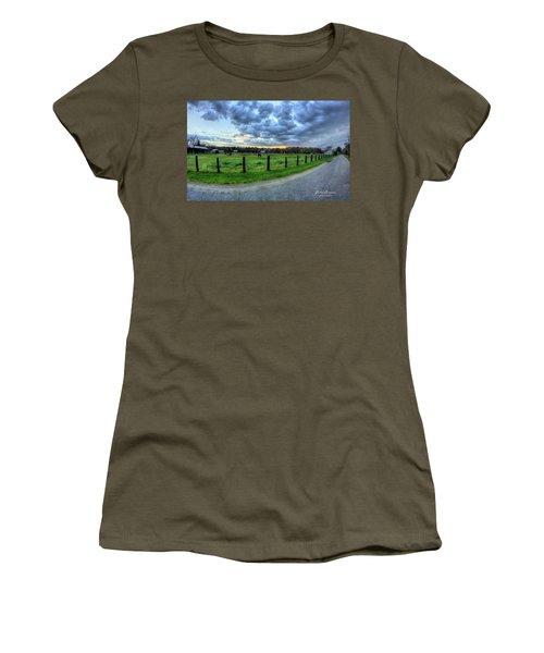 Storm Clouds Over Main Street Women's T-Shirt (Junior Cut) by John Loreaux
