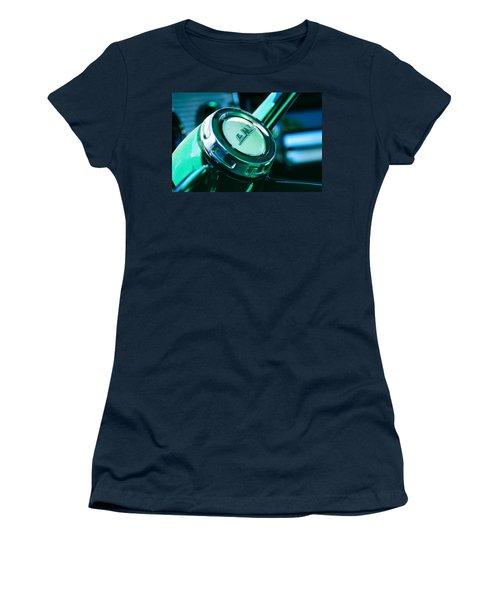 Women's T-Shirt featuring the photograph 1958 Gmc Suburban Steering Wheel Emblem by Jill Reger