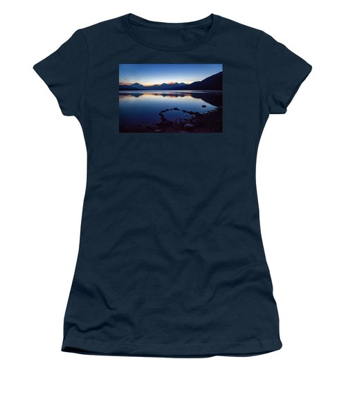 Women's T-Shirt (Athletic Fit) featuring the photograph Lake Mcdonald Sunrise Tranquility by Lon Dittrick