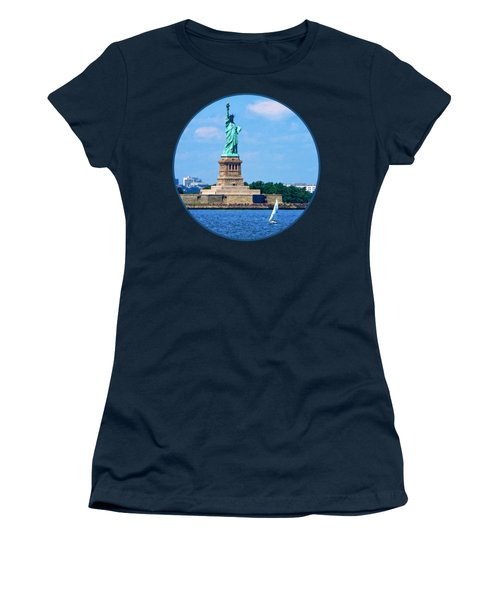 Manhattan - Sailboat By Statue Of Liberty Women's T-Shirt (Junior Cut) by Susan Savad