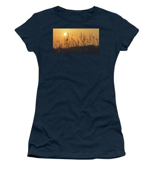 Women's T-Shirt featuring the photograph View Of Sun Setting Behind Long Grass A by Jacek Wojnarowski
