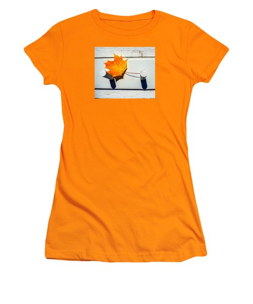 Women's T-Shirt (Junior Cut) featuring the photograph Autumn Leaf On Pegs by Gary Slawsky