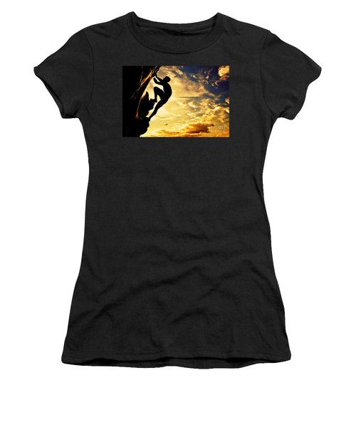 A Silhouette Of Man Free Climbing On Rock Mountain At Sunset Women's T-Shirt (Junior Cut) by Michal Bednarek