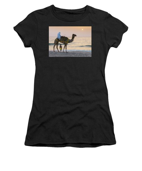 Little Boy Stares In Amazement At A Camel Riding On Marina Beach In Dubai, United Arab Emirates -  Women's T-Shirt