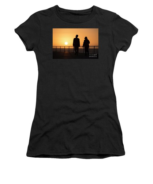 A Couple In Silhouette Walking Into The Sunset Women's T-Shirt