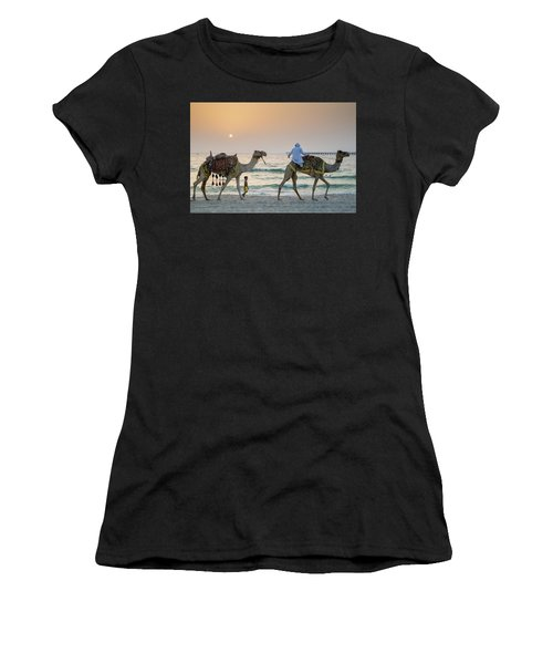 A Little Boy Stares In Amazement At A Camel Riding On Marina Beach In Dubai, United Arab Emirates Women's T-Shirt
