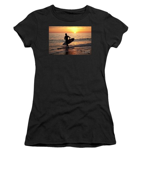 A Young Man Surfing At Sunset Off Aberystwyth Beach, Wales Uk Women's T-Shirt