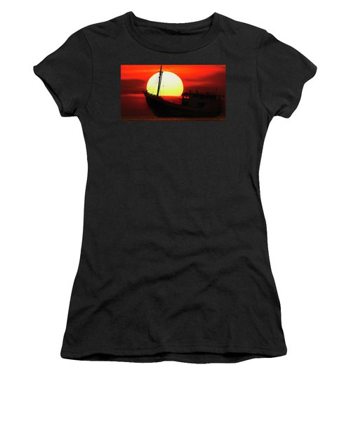 Women's T-Shirt featuring the photograph Boatman Enjoying Sunset by Pradeep Raja Prints