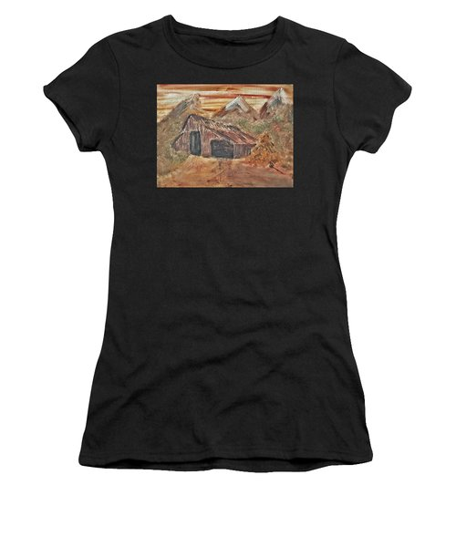 Old Farmhouse With Hay Stack In A Snow Capped Mountain Range With Tractor Tracks Gouged In The Soft  Women's T-Shirt (Athletic Fit)