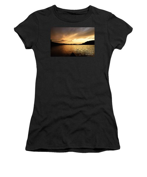 Women's T-Shirt (Junior Cut) featuring the photograph Paddling At Sunset On Kekekabic Lake by Larry Ricker