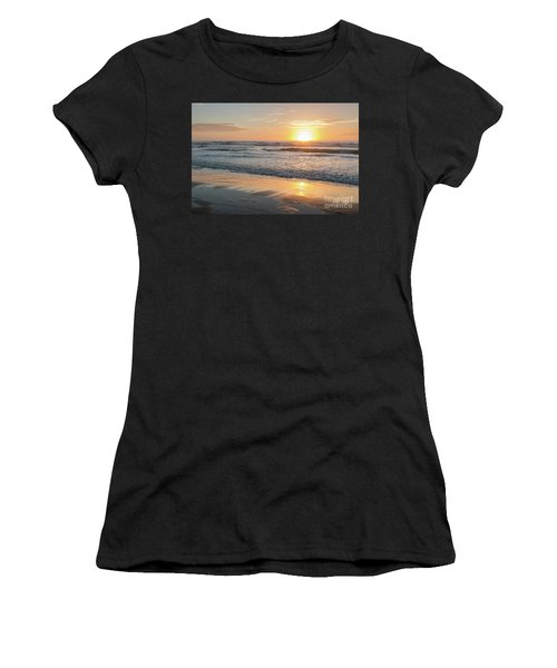 Rising Sun Reflecting On Wet Sand With Calm Ocean Waves In The B Women's T-Shirt