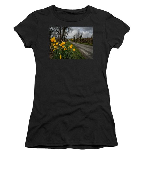 Women's T-Shirt (Athletic Fit) featuring the photograph Spring Daffodils On An Irish Country Road by James Truett